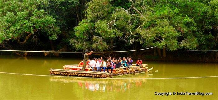 Visitors carried to Kuruva Island in bamboo raft