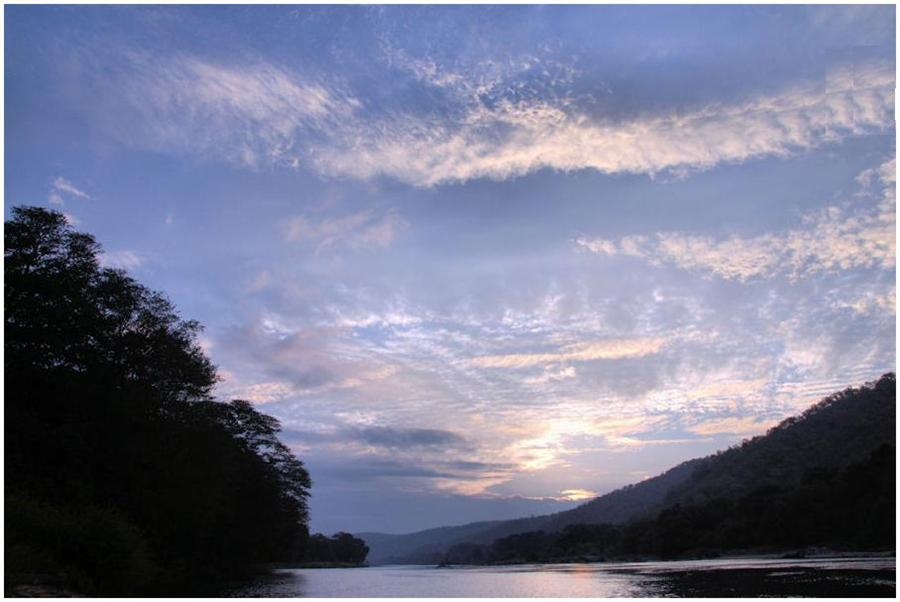 Sun rise and Cauvey river at Galibore fishing camp near Bengaluru
