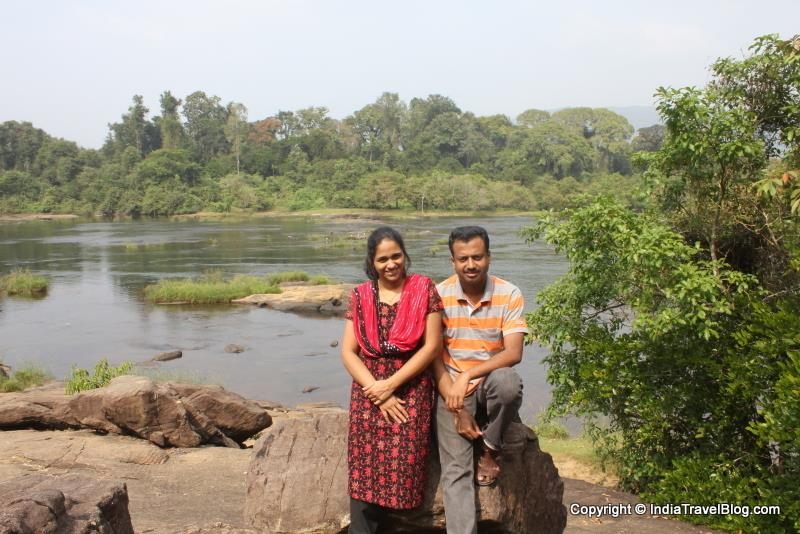 My wife and I for a photo. Periyar river is in the background
