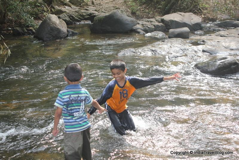 Kids playing in the river